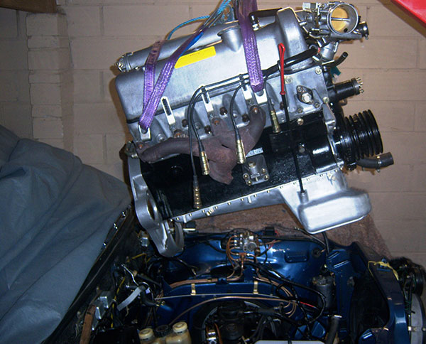 Classic restored  Mercedes 6.3 engine being fitted